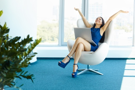 Business woman celebrates successful deal at office. Business People